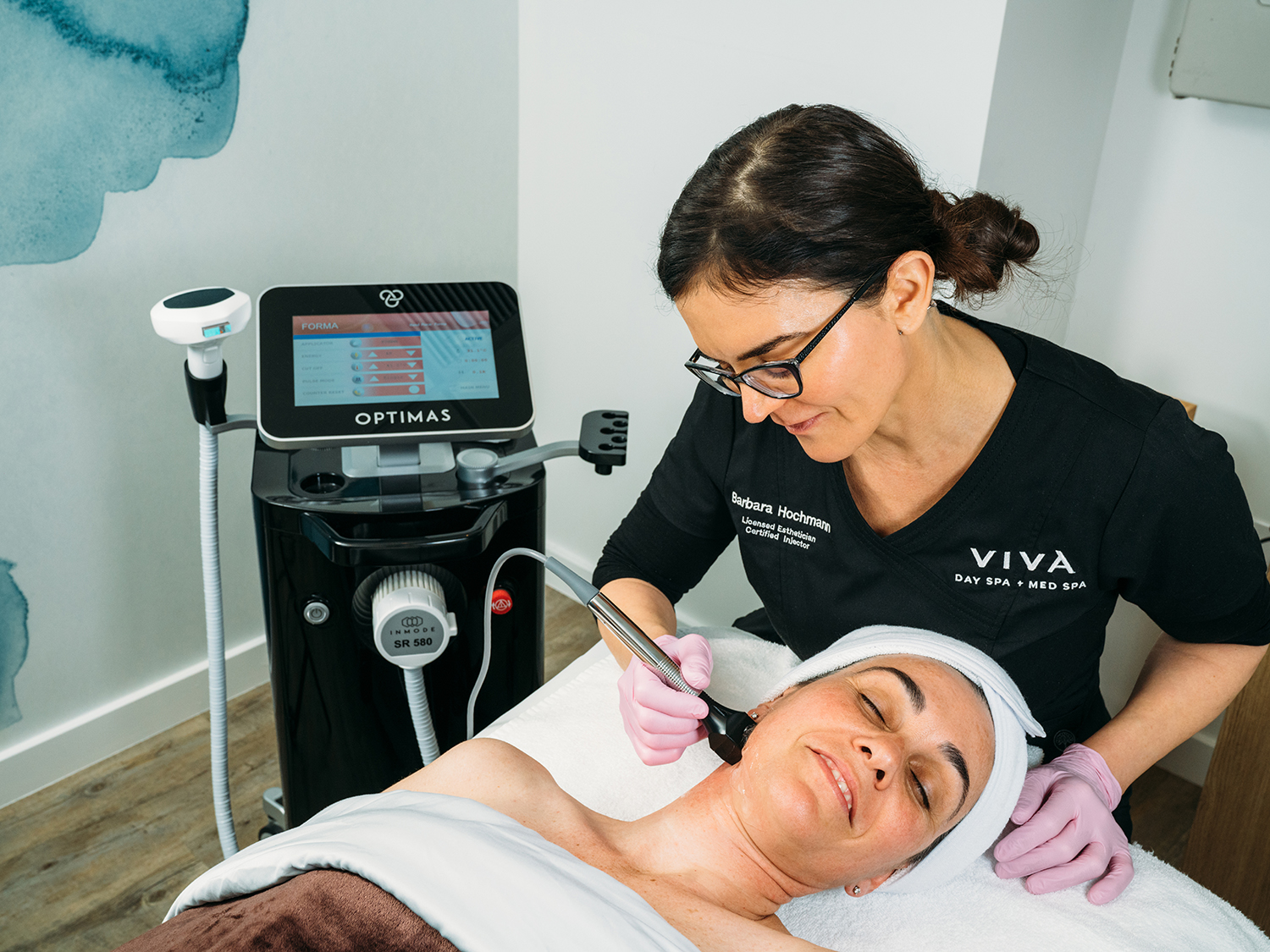 Guest receiving an anti-aging Forma skin tightening med spa treatment.