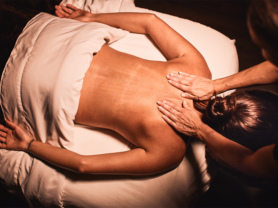 Massage therapist giving a woman at Swedish Massage at Viva Day Spa in Austin, TX.