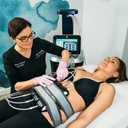 Evolve Trim body contouring treatment at Viva in Austin to melt fat, tighten skin and reshape the body.