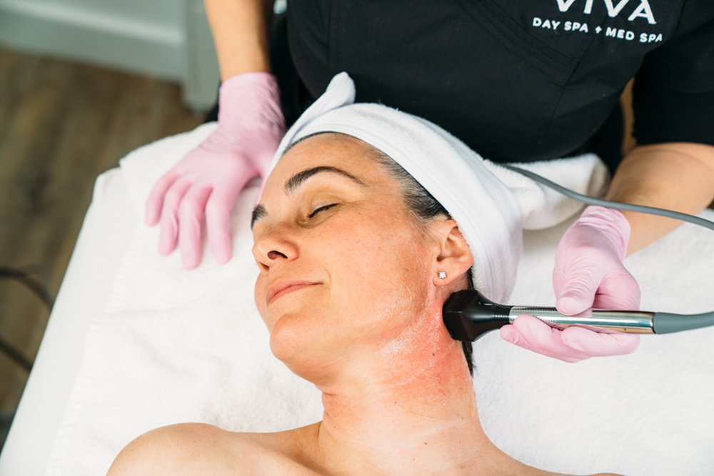 Close-up of a woman receiving the Forma facial skin tightening treatment at Viva Day Spa + Med Spa in Austin, TX